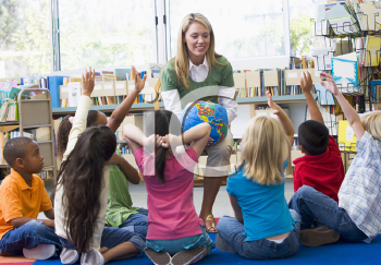 Royalty Free Clipart Image of a Teacher Showing Her Students a Globe
