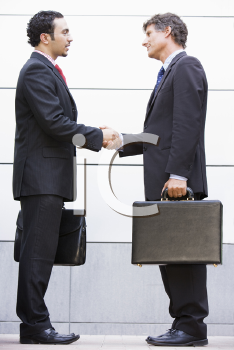 Royalty Free Photo of Two Businessmen Shaking Hands