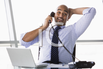 Royalty Free Photo of a Man in an Office on the Phone