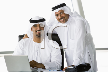 Royalty Free Photo of Two Eastern Men in an Office