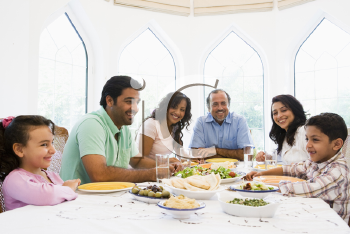 Royalty Free Photo of a Family at a Dinner Table