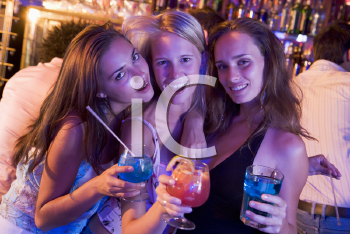 Royalty Free Photo of Young Women With Drinks in a Bar