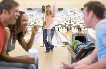 Royalty Free Photo of Two Couples Bowling