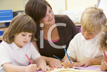 Royalty Free Photo of Students Writing in Class