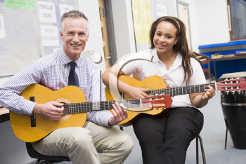 Royalty Free Photo of a Guitar Teacher and Student