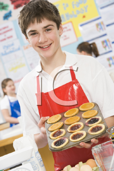 Royalty Free Photo of a Boy With Tarts