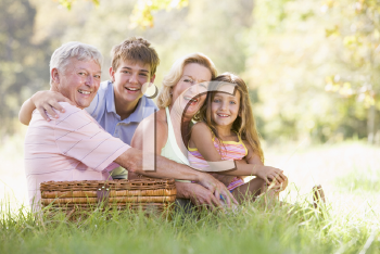 Royalty Free Photo of People Having a Picnic With Their Grandchildren
