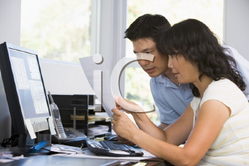 Royalty Free Photo of a Couple at a Computer