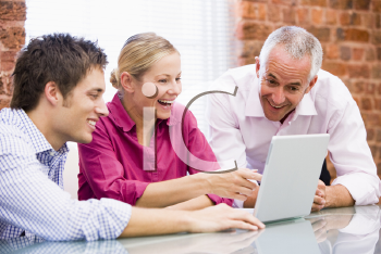 Royalty Free Photo of Three People at a Laptop