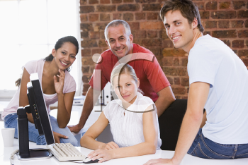 Royalty Free Photo of Four People Around a Computer