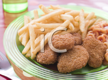 Royalty Free Photo of Chicken Nuggets With Spaghetti Hoops and Chips