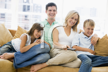 Royalty Free Photo of a Family With a Remote Control