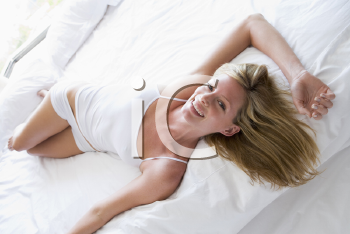 Royalty Free Photo of a Woman Lying on the Bed