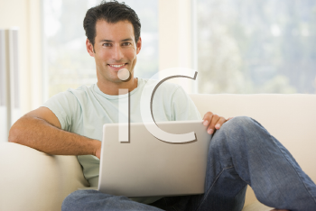 Royalty Free Photo of a Man With a Laptop