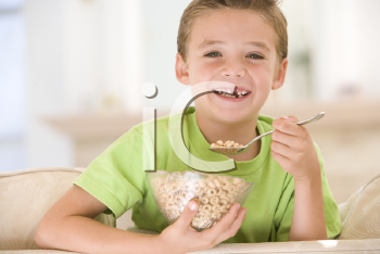 Royalty Free Photo of a Boy Eating Cereal