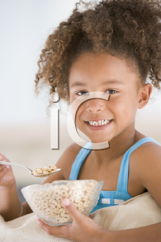 Royalty Free Photo of a Girl Eating Cereal