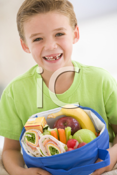 Royalty Free Photo of a Boy With a Lunch Box
