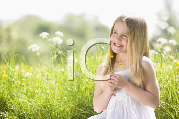 Royalty Free Photo of a Child Picking Flowers