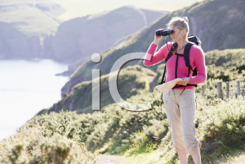 Royalty Free Photo of a Woman With Binoculars on a Trail