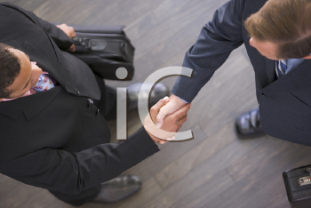 Royalty Free Photo of Businessmen Shaking Hands