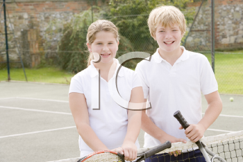 Royalty Free Photo of Two Children on a Tennis Court