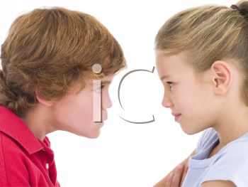 Royalty Free Photo of a Brother and Sister Staring at Each Other