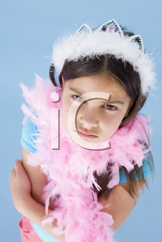 Royalty Free Photo of a Girl in a Feathered Crown and Boa
