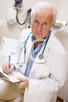 Royalty Free Photo of a Middle-Aged Doctor With a Clipboard