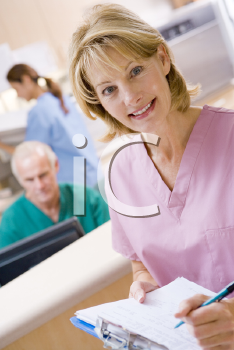 Royalty Free Photo of a Nurse at a Reception Area