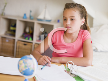 Royalty Free Photo of a Girl Doing Her Homework