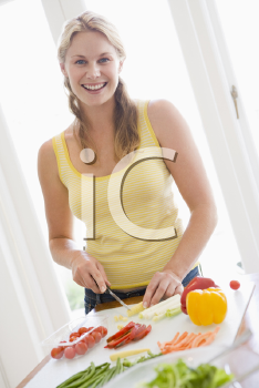 Royalty Free Photo of a Woman Preparing a Meal