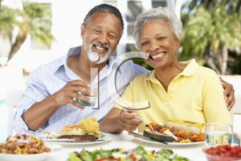 Royalty Free Photo of a Couple Eating Outside
