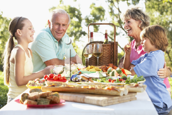 Royalty Free Photo of a Family Eating Outside