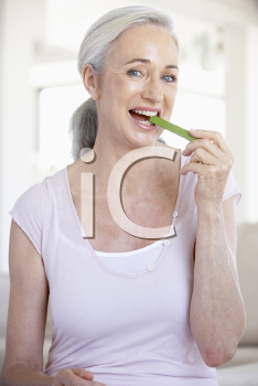Royalty Free Photo of a Woman Eating Celery