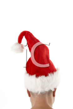 Royalty Free Photo of a Man Wearing a Santa Hat From the Back