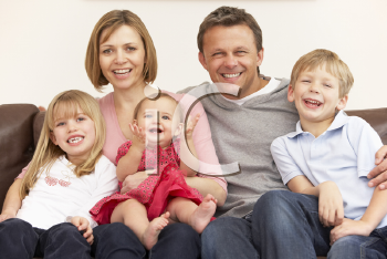 Royalty Free Photo of a Family on a Sofa