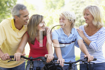Royalty Free Photo of a Family on Bikes