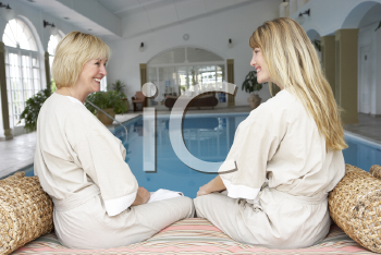 Royalty Free Photo of Two Women Relaxing By a Pool