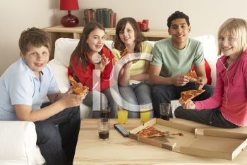 Royalty Free Photo of a Group of Kids Eating Pizza