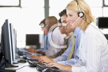 Royalty Free Photo of Stock Traders With Headsets