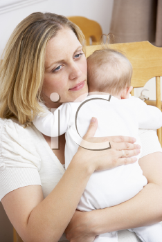 Royalty Free Photo of a Mother Rocking a Baby