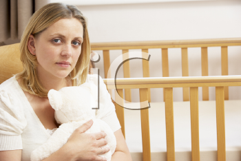 Royalty Free Photo of a Sad Mother in an Empty Nursery