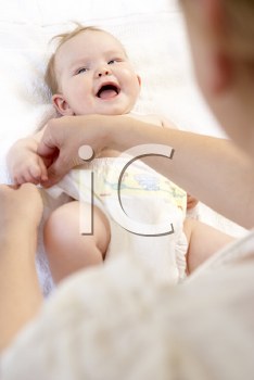 Royalty Free Photo of a Baby Having Her Diaper Changed