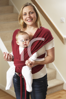 Royalty Free Photo of a Baby in a Sling With Her Mother