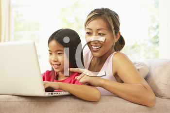 Royalty Free Photo of a Mother and Daughter With a Computer