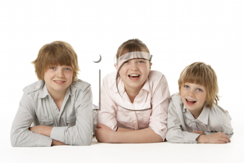 Studio Portrait Of Brothers And Sister