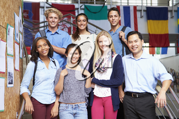 High School Students And Teacher Standing Outside Building