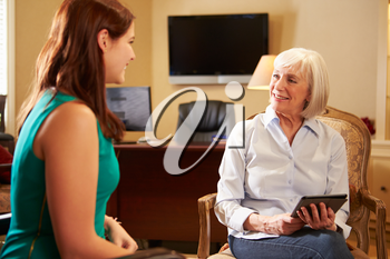 Young Woman Talking To Counsellor Using Digital Tablet