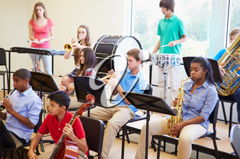 Pupils Playing Musical Instruments In School Orchestra