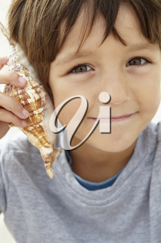 Young boy with seashell